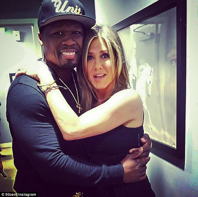 'Me and Jennifer Aniston,(CAKE) another GOLDEN GLOBE on the way!' Jennifer Aniston cuddled up to her BFF Chelsea Handler's ex-boyfriend 50 Cent in an Instagram posted Friday