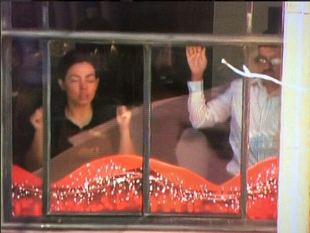 Terrified customers and employees were among those standing with their hands against the window at the Lindt cafe in Sydney