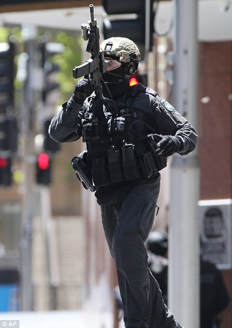 Armed police have sealed off streets around the cafe and Martin Place station is shut