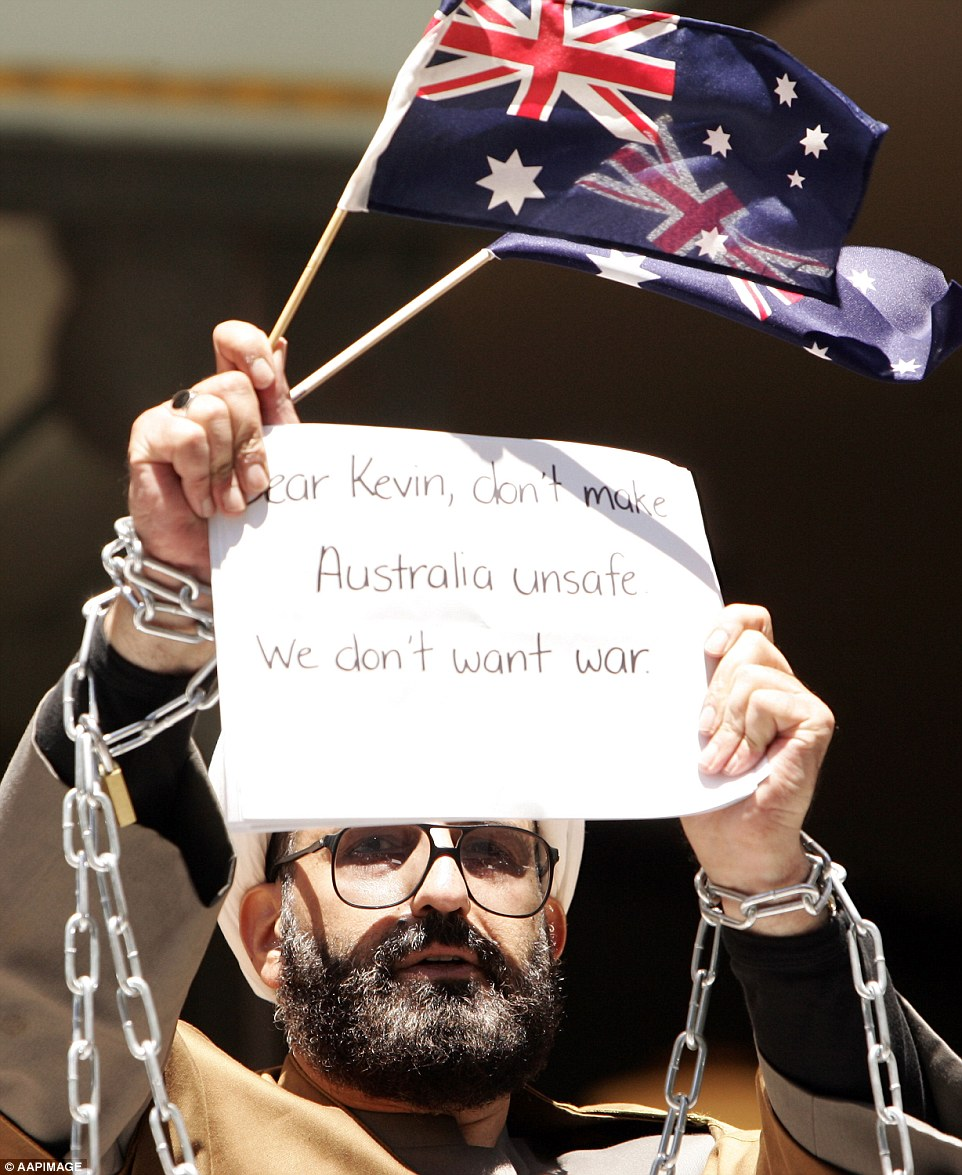 Man Haron Monis bound in chains in protest of his charges of using the postal service for menace