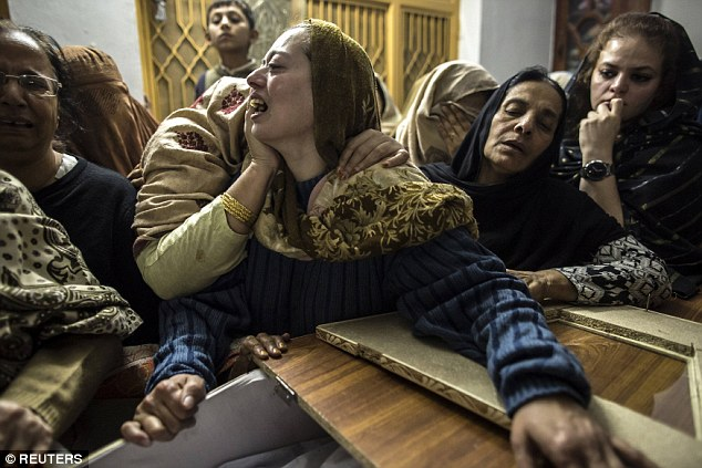 A mother mourns her son Mohammed Ali Khan, 15, a student who was killed during the atrocity - the deadliest in Pakistan's history