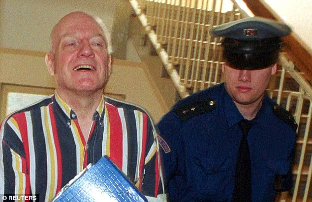 Paid local boys for sex acts: Denning (left) is escorted by a justice guard to a court hearing in the Czech Republic in March 2000, three years after he was jailed for the sexual abuse of eight boys in Prague in 1997