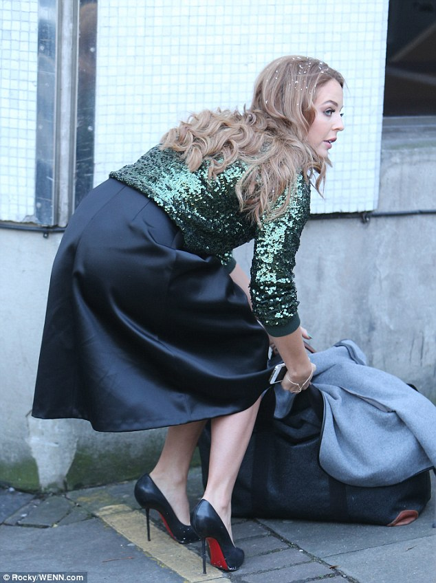 Lydia Bright wears sequin top with her satin skirt  Daily
