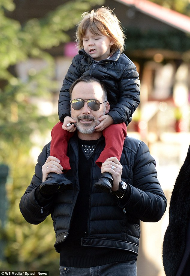 Matching: David wore a similar coat to his adorable son Zachary when his little man sat on his shoulders