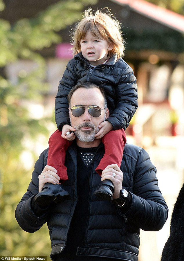 Family time: David Furnish, pictured with eldest son Zachary, took Elijah and his husband-to-be Elton John to Winter Wonderland ahead of their weekend wedding