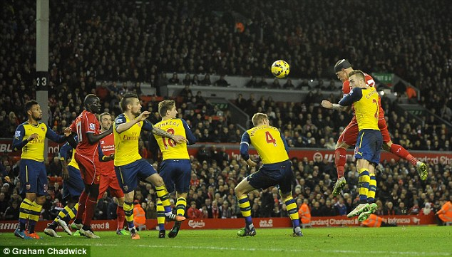 Mertesacker (third right) does not put up much resistance as Skrtel powers in