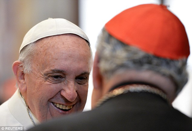 All smiles: At the end of the speech, Francis asked the prelates to pray that the 'wounds of the sins that each one of us carries are healed'