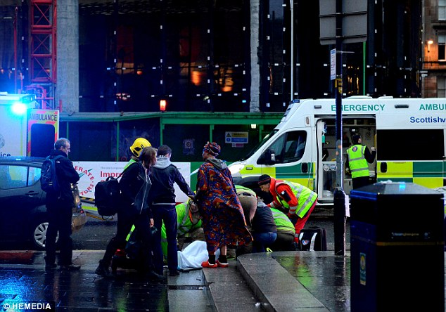 Police closed off the square as a huge team of emergency service workers moved in to treat the wounded