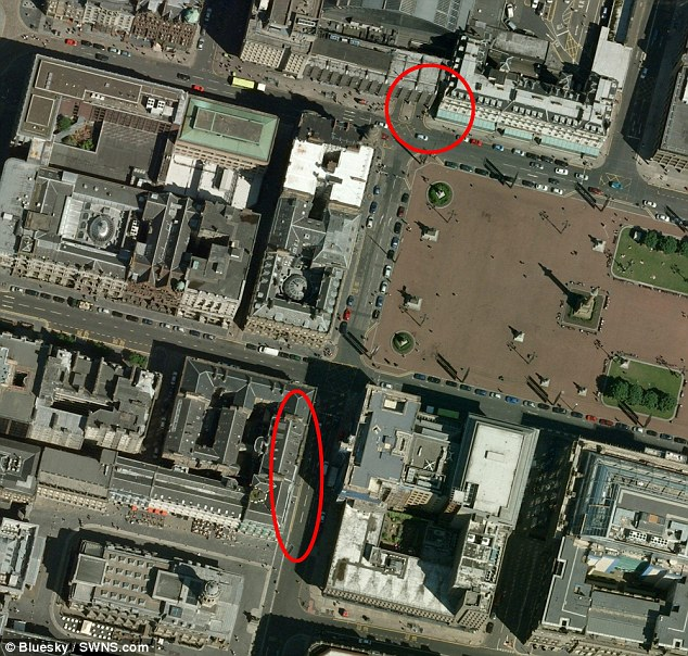 An aerial shot of George Square shows the stretch of pavement where pedestrians were hit (circled, bottom) and the corner of the Millennium Hotel where the lorry ended up, crashed against a wall (circled, top)