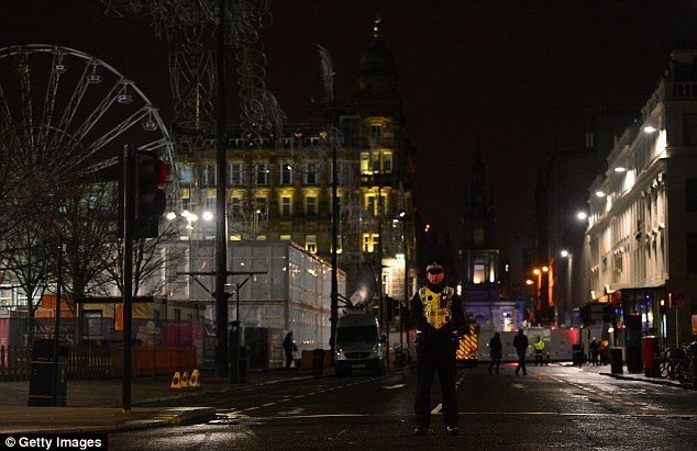 Investigation: Emergency services remained at the scene of the carnage late into the night