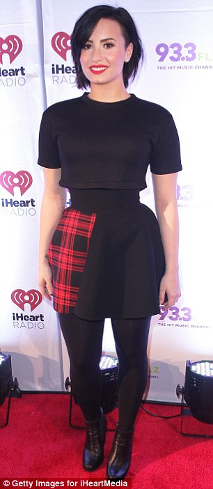 Demi Lovato Gives Her Black Outfit A Streak Of Plaid At