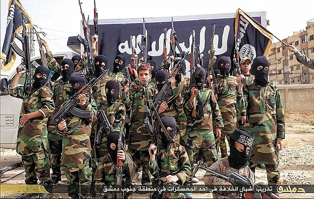 Images of child soldiers killed fighting in Syria are being shared online by the terror group as propaganda, with fellow jihadis praising the young children as martyrs (file image)