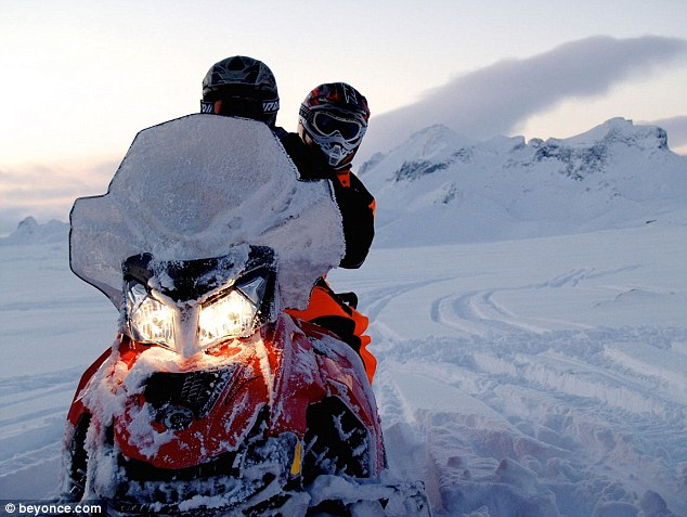 Vroom: The series then depicts the couple sharing a snow mobile in a desolate landscape