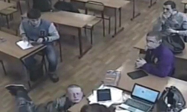 Horror fall:  Russian student Sergei Casper fatally hits his throat on the edge of a desk crushing his oesophagus after being tied up by bullies and dunked in a toilet