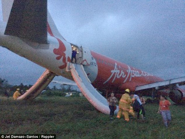 Escape: Local journalist Jet Damazo-Santos was on board the plane and uploaded photographs to Twitter showing chaotic scenes as passengers were forced to disembark the aircraft on emergency slides