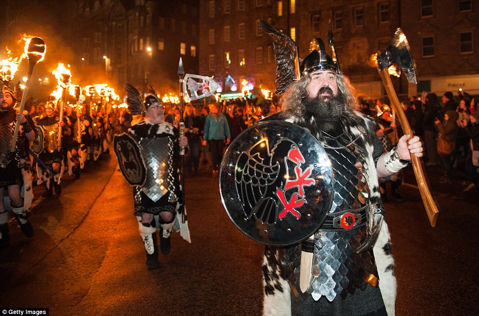 They sure know how to party: Men dressed as Vikings take part in the torchlight procession as it makes its way through Edinburgh for the start of the Hogmanay celebrations on Tuesday