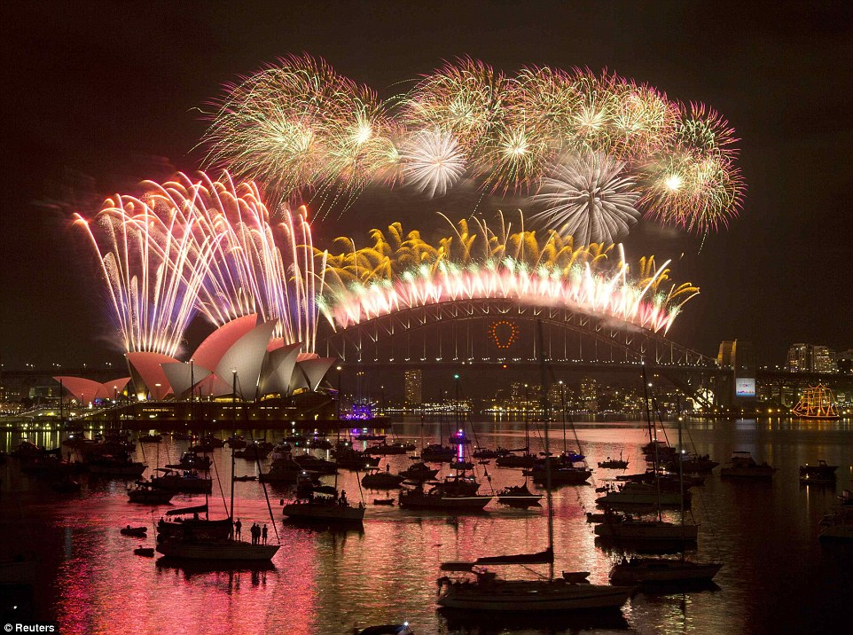 And we're off: An estimated 1.6million people gathered on the shores of the Sydney Harbour for the midnight fireworks show