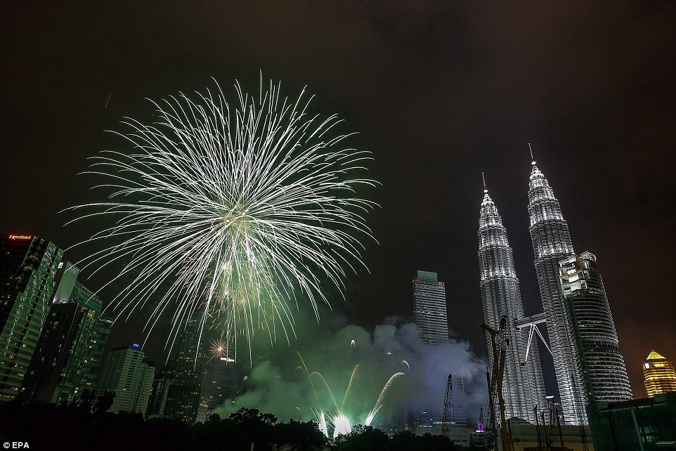 Malaysia celebrates the New Year 2015 in modest mood in honor to the victims of the Malaysia Airlines MH370 and MH17 plane tragedies and floods that hit the country at this time claimed 24 lives and more than 200,000 have been evacuated