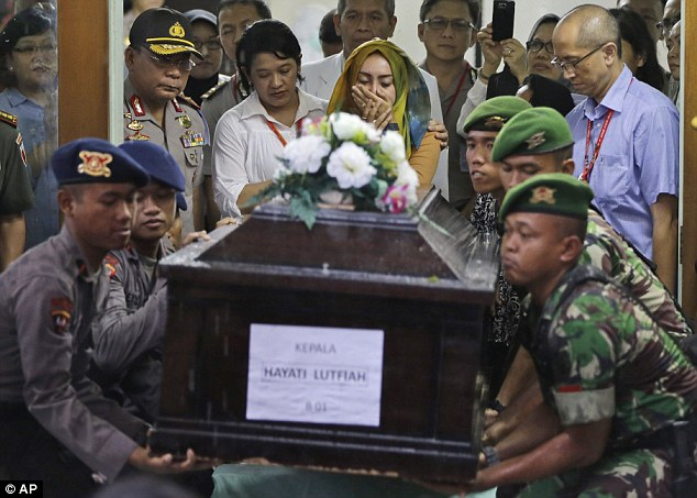 The fresh analysis came as the first victim of the crash was identified asHayati Lutfiah Hamid and her remains were handed over to her family in emotional scenes at a hospital in Surabaya