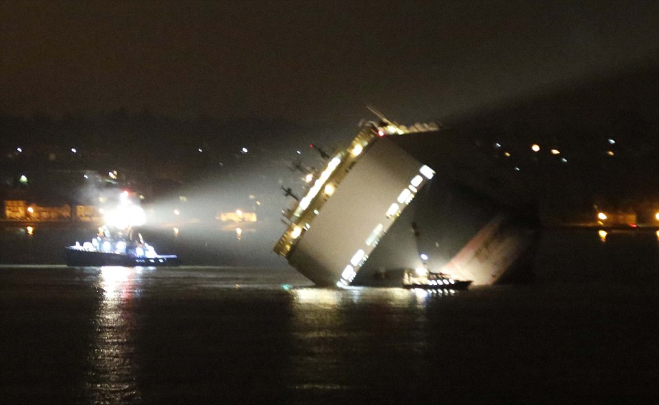 The Hoegh Osaka pictured last night as it is surrounded by rescue boats while listing at a 45 degree angle