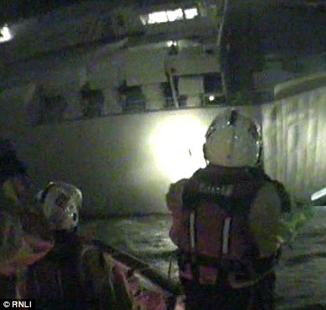 Members of RNLI pictured as they inspect the listing Hoegh Osaka late last night