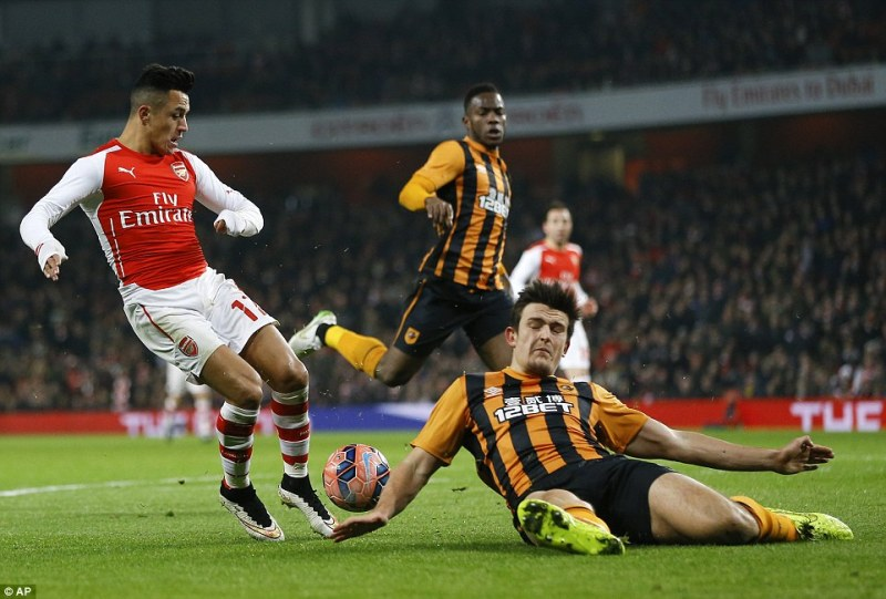 Sanchez has a shot blocked by Hull defenderHarry Maguire as Arsenal miss one of many first half chances