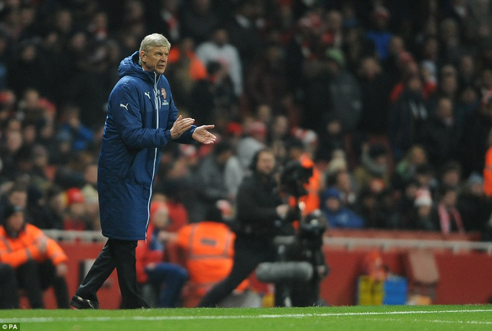 Arsenal manager Arsene Wenger encourages his players to push forward during a dominant opening half