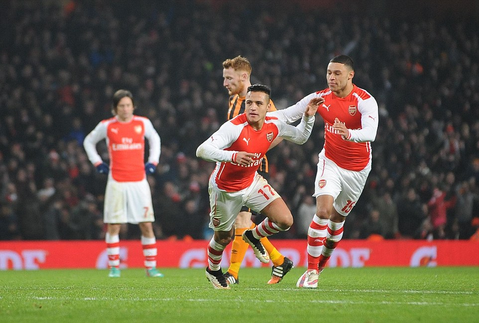 Sanchez wheels away after scoring his 16th goal of a sensational debut season for the Gunners