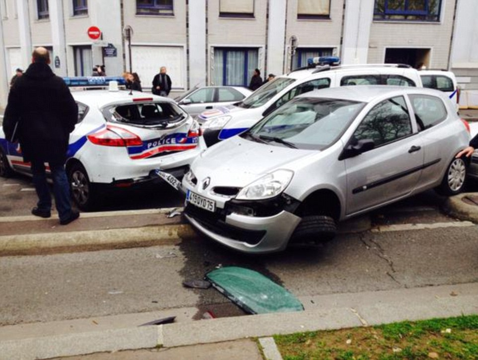 Officers were involved in a gunfight with the men, who escaped in a hijacked car and sped away from the office towards east Paris