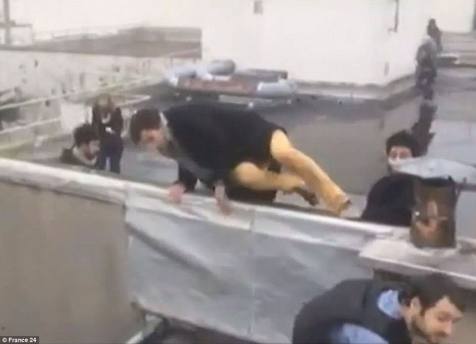 Terror: In footage filmed from a rooftop, people are seen running for cover as the gunmen rampage through the building