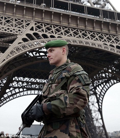 A French soldier patrols in front of the Eiffel Tower on January 7, 2015 in Paris as the capital was placed under the highest alert status after heavily armed gunmen shouting Islamist slogans stormed French satirical newspaper Charlie Hebdo and shot dead at least 12 people in the deadliest attack in France in four decades. Police launched a massive manhunt for the masked attackers who reportedly hijacked a car and sped off, running over a pedestrian and shooting at officers. AFP PHOTO / JOEL SAGETJOEL SAGET/AFP/Getty Images