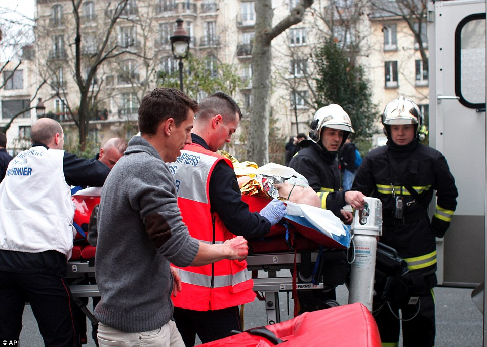 A man is carried into an ambulance. Ten people were reportedly in wounded, four critically, in the attack by suspected Al Qaeda militants