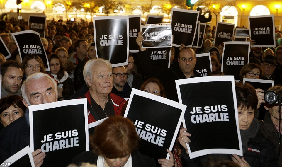 Slogan: 'Je Suis Charlie' posters were held by many in Nice. Others waved banners with slogans such as 'Press freedom has no price'