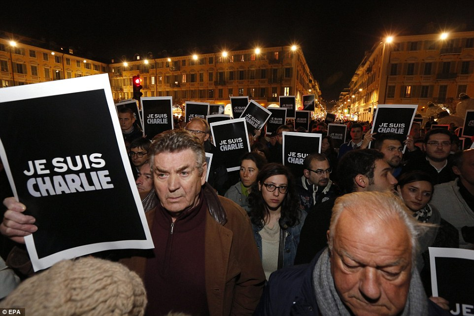 Support: Crowds of people carrying 'Je Suis Charlie' placards met in the centre of Nice, in the south of France tonight in a show of solidarity