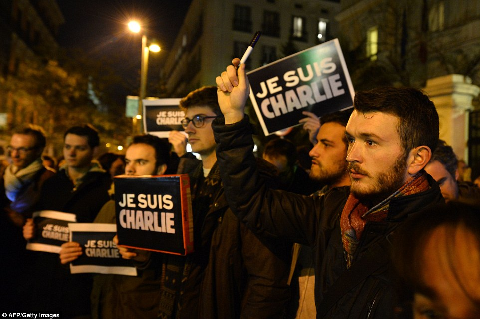 Madrid: People holding makeshift banners reading Je Suis Charlie gathered outside the French embassy in Madrid, in another organised rally
