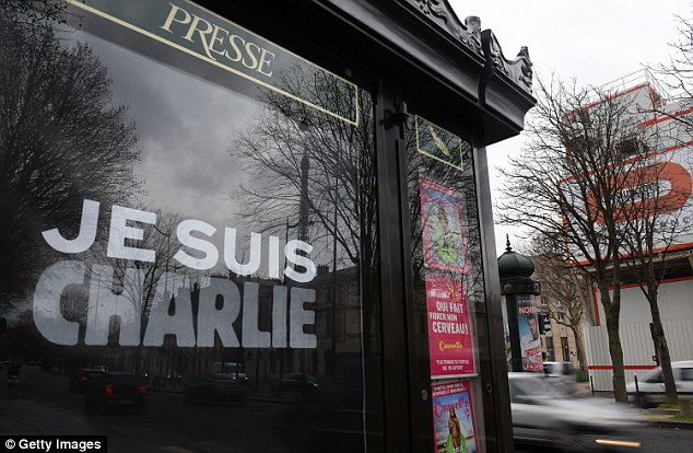 The rallying cry, which translates to 'I Am Charlie' is being used in demonstrations across the globe. Pictured is the phrase on a newsstand in Paris