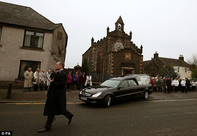 Mourners lined the streets of the small town as the funeral cortège made its way along the main road