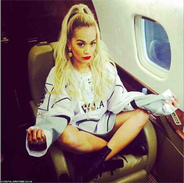 Rita shares pictures of her glamorous lifestyle with her fans - like this one on board a private plane