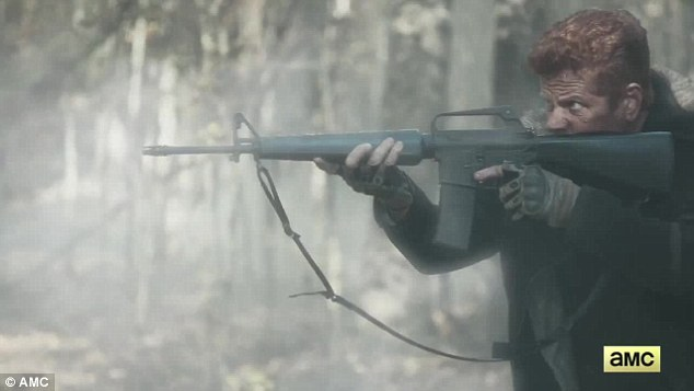 Ginger thunder: Sergeant Abraham Ford (Michael Cudlitz) warily peered through the scope of his automatic rifle