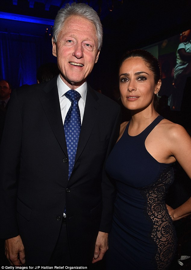 Top approval:The dress certainly impressed former President Bill Clinton who happily smiled for pictures with the star