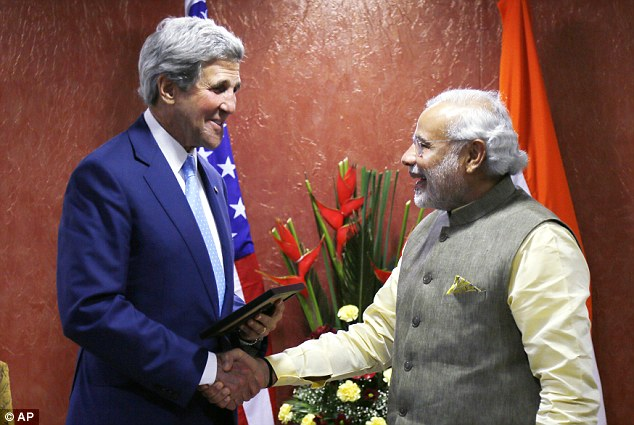 OUT OF TOWN: Secretary of State John Kerry could not attend the rally because he was in India, preparing for President Obama's upcoming visit to the country. Pictured above on Sunday with Indian Prime Minister Narendra Modi