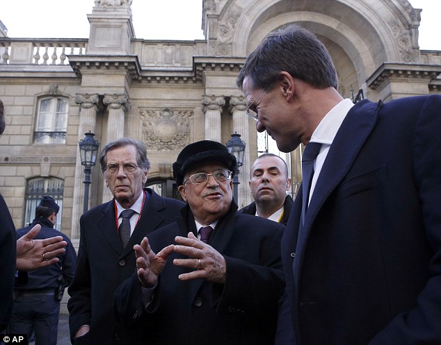 Mistake? Several political talking heads called President Obama's absence a 'mistake'. Above, Palestinian President Mahmoud Abbas (center)  leaves the Elysee Palace to participate in the march