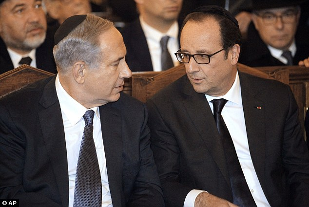 Protected: Security was an orchestrated effort, but that fact that Israeli Prime Minister Benjamin Netanyahu (left) joined shows how secure the dignitaries were. Pictured above with French President Francois Hollande (right) during a ceremony at the Grand Synagogue in Paris, following the march.