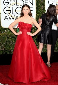 Catherine Zeta Jones dons a strapless satin ball gown on ...