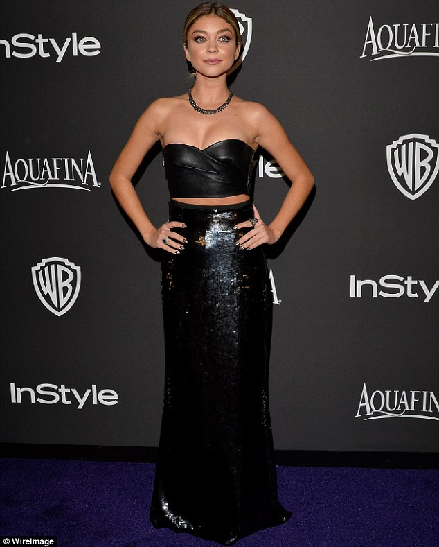 Modern stunner: Sarah Hyland, 24, showed off her slender frame in a strapless leather frock and black sequined maxi dress