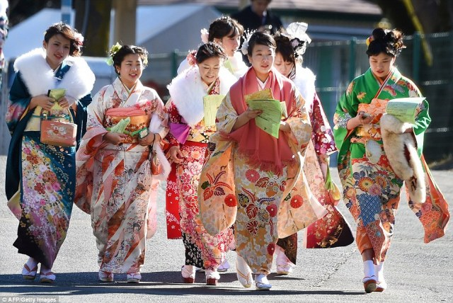 Bright idea: The colourful kimonos made for quite a sight on Monday as thousands dressed up for the annual festivities