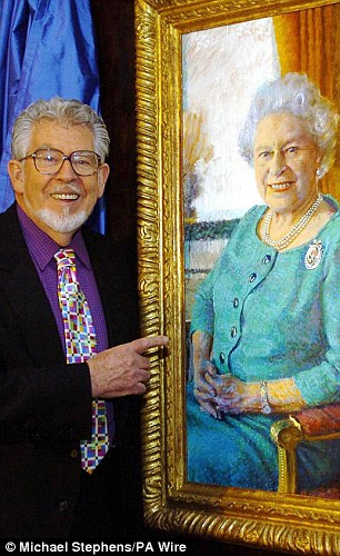 Harris poses with his portrait of the Queen.