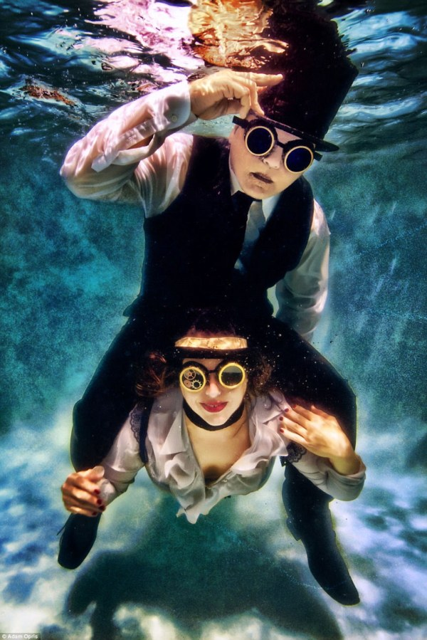 Adam Opris Captures Clothed Couples Kiss And Pose In Ethereal Underwater Engagement