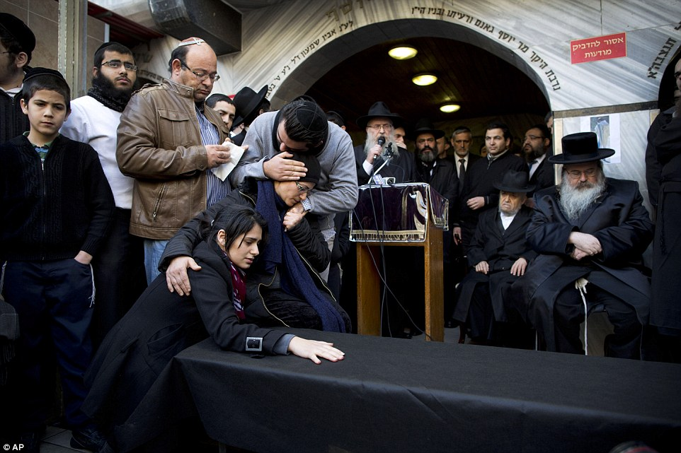 Inconsolable: Relatives of Yoav Hattab, a victim of the attack on a kosher grocery store in Paris, gather for his funeral procession in the city of Bnei Brak near Tel Aviv, Israel, ahead of his burial at a cemetery in Jerusalem