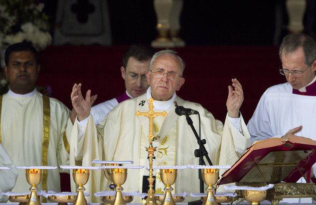 Pope Francis raises his hands during Mass at Colombo's seafront Galle Face Green for the canonization ceremony of Joseph Vaz, Wednesday, Jan. 14, 2015. Franc...